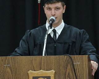"IMG 9199: ÊClass president David Dilla gives a speech titled ""I'll only take a minute"" during his classes commencement on Sunday at the Struthers Field House. ÊDustin Livesay Ê
