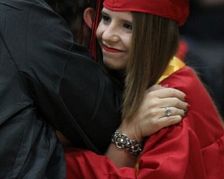 IMG 9204: Valedictorian ÊAlyssa Gage gives her show choir director Angela Russo a hug after finishing her last performance during commencement at the Struthers Field House on Sunday. ÊDustin Livesay Ê| ÊThe Vindicator Ê5/26/13 ÊStruthers High School. Ê