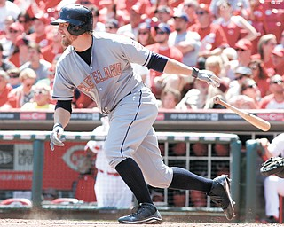 Cleveland Indians' Mark Reynolds hits a single during a game against the Cincinnati Reds on Monday in Cincinnati.