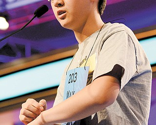 Max Lee of Canfield competes in the second round of the 2013 Scripps National Spelling Bee in Oxon Hill, Md., Wednesday.