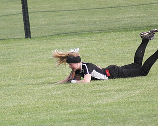 The ball rolls away from Canfield's right fielder Sydney Opladen after a diving attempt in the sixth inning of Wednesday's Division II regional semifinal against Navarre Fairless at Firestone Stadium in Akron. On the play, Opladen sprinted toward center where the ball glanced off the top of her glove. The Cardinals fell 6-2 to the Falcons.