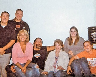 """Here's a """"group hug,"""" sent in by Betsy Koneval of Youngstown. From left are Corey Fonner, friend Alden, Jill Fonner, Truck Toth, Betsy, Jenna Fonner and Megan Crosby. Betsy says they all love to spend time with family."""