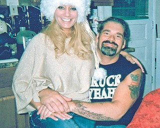 """Betsy Koneval of Youngstown submitted this photo she calls """"Lovin' Couple + 1,"""" taken of her daughter, Jill Fonner, with boyfriend Truck Toth. At right is Jill's brother Russ Koneval. All live in Youngstown."""