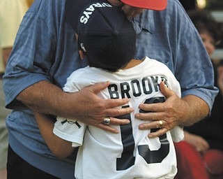 """Cathy Brooks submitted this photo of her son, Danny Brooks of Austintown, and his grandfather, Gerry Brooks of Canfield. Cathy said her father-in-law loved baseball, and never missed one of Danny's games, even when he became ill. """"He always waited until the end of the game to give Danny a hug,"""" she wrote."""