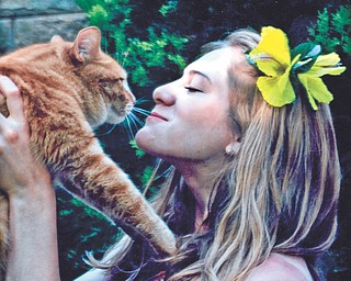Leanna Hartsough, a Youngstown State University junior, and her cat Marshmallo. Photo submitted by Lana VanAuker of Canfield.