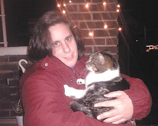 Alison Stanislaw of Youngstown hugs Tagger the neighborhood cat. Photo sent in by Sherry Parent of Youngstown.