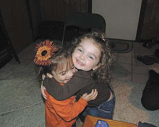 Now here are some really happy huggers! Proud grandpa James DeToro of Austintown sent in this photo of grandchildren Cecilia DeToro, 2, and Riley Collins, 3.