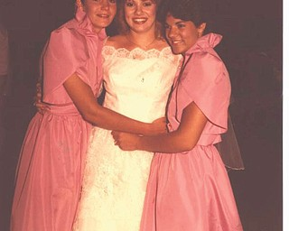 """Sheri Morris sent in this photo, with this description: """"This is from my wedding day, June 16, 1984, of the Donnelly sisters. Today we're known as Shelly Seese, Sheri Morris and Shannon Zappia. I'm the oldest and was the first to get married. This was taken right before I was leaving the reception."""""""