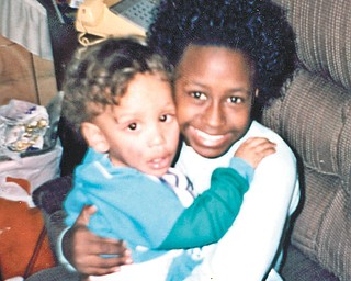 Othella May of Youngstown submitted this picture of hugging cousins Michelle Pete and Daniel May, both of Youngstown.