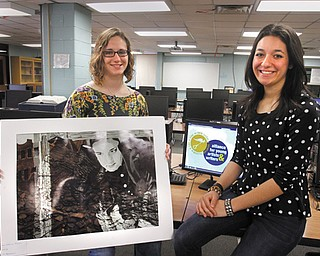 """Catherine Brown, 19, left, and Ariana Ellis, 18, who both graduate from Canfield High School next month, are 2013 National Medal winners in the 90th Scholastic Art and Writing Awards. Brown won an American Visions Medal for her mixed media artwork, """"Frightened,"""" and Ellis won a silver medal for each of her two writing submissions."""
