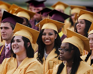 MADELYN P. HASTINGS | THE VINDICATOR  Liberty High School's class of 2013 smiles after receiving their diplomas.