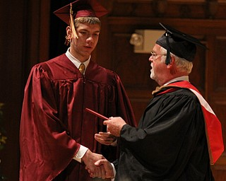 Douglas Caputo receives his diploma from Cardinal Mooney principal John Young during commencement at Stambaugh Auditorium in Youngstown on Sunday.  Dustin Livesay  6/2/13  Youngstown.