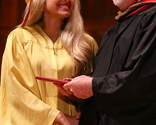 Sabrina Saadey smiles at Mooney principal John Young after receiving her diploma during commencement at Stambaugh Auditorium in Youngstown on Sunday.  Dustin Livesay  6/2/13  Youngstown.