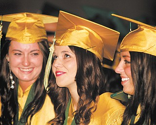 From left, Brooke Conlin, Sammantha Bonacci and Katelyn Shells are all smiles at their graduation from Ursuline High School in Sunday's Stambaugh Auditorium commencement. Ninety-five graduates received their diplomas.