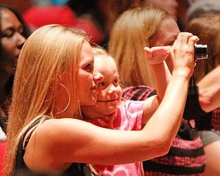 ROBERT K. YOSAY  | THE VINDICATOR  amking a memory is Mia 3 Braun and Her mom Terra  as they take a picture of their ( uncle and brother Phoenix M Harley   Chaney Campus High School Commencement Ceremony graduates 31