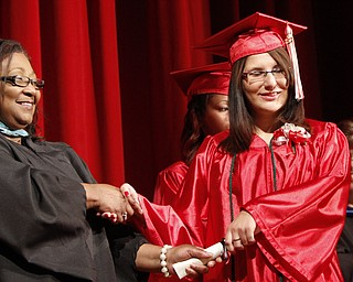 ROBERT K. YOSAY  | THE VINDICATOR  Linda Cosma smiles as she receives her diploma from Diane Rollins Principal  Chaney Campus High School Commencement Ceremony graduates 31
