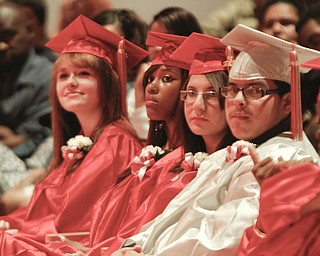 ROBERT K. YOSAY  | THE VINDICATOR  Rapt attention is from left Megan Christ - Dejeux L Comer - Linda Cosma - and Fabian T Don Juan   Chaney Campus High School Commencement Ceremony graduates 31