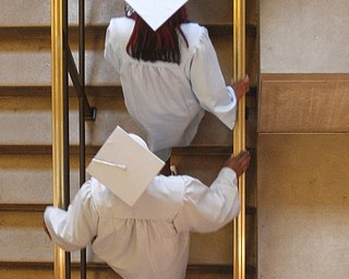 ROBERT K. YOSAY  | THE VINDICATOR  East  High Students climb the stairs as they enter  the auditorium -    169 members of the East High School Class of 2013 who received their diplomas Thursday during the commencement ceremony at Stambaugh Auditorium.