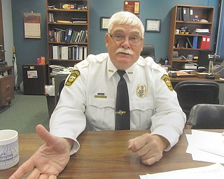 Tim Bowers, Warren police chief, makes a point during an interview at his office at the Warren Police Department. Bowers retires this month after 35 years as a police officer, four years as chief.