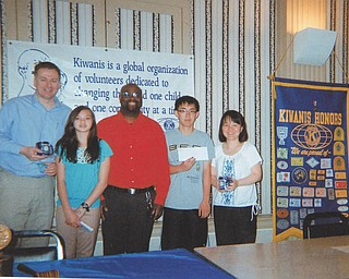 SPECIAL TO THE VINDICATOR The Downtown Kiwanis Club honored the grand champion and runner-up of the 80th annual Vindicator Regional Spelling Bee with gift cards to Barnes & Noble bookstores at a May 17 luncheon at the downtown YMCA. Brad Harris, vice president of the Kiwanis Club, presented the runner-up, Tamsin Day, an eighth-grader at Willow Creek Learning Center in Boardman, with a $100 gift card. A $200 gift card went to the champion, Max Lee, an eighth-grader at Canfield Middle School. From left are Alan Day, Tamsin's father; Tamsin; Harris; and Max and his mother, Linglan Liu Lee.