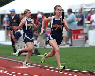 United's Maggie Briceland, right, runs after taking the handoff from Emily Guappone, left, during the OHSAA Girl's Division III State 4x800 relay Track Finals, Friday, June 7, 2013, at the Ohio State University, in Columbus, Ohio. (Photo For The Vindicator by Terry Gilliam)