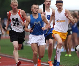 Maplewood's Mike Dahmen, second left, and McDonald's Robert Johnson, right, run during the OHSAA Boy's Division III State 4x800 relay Finals, Friday, June 7, 2013, at the Ohio State University, in Columbus, Ohio. (Photo For The Vindicator by Terry Gilliam)