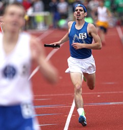 Maplewood's Mike Dahmen, right, runs to the finish during the OHSAA Boy's Division III State 4x800 relay Finals, Friday, June 7, 2013, at the Ohio State University, in Columbus, Ohio. (Photo For The Vindicator by Terry Gilliam)
