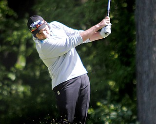Greatest Golfer of the Valley junior qualifier, Donavan Ray, golfs at Pine Lakes Golf Club in Hubbard on May 25, 2013.
