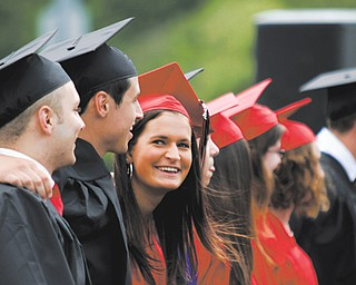 Stephanie Carrocce smiles while singing the alma mater during Canfield High School's commencement exercises Sunday afternoon at the school's football stadium.