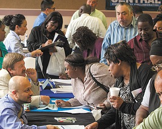 Job seekers inquire for positions at the 12th annual Mission career fair in the skid-row area of Los Angeles. The Labor Department reported Tuesday that the number of people who quit their jobs rose in April, as did hiring.