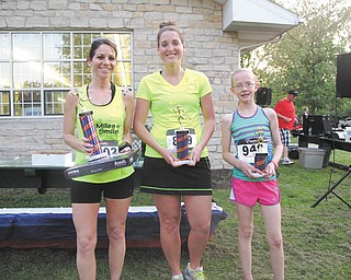 The Vision for Veterans 5K race May 17 in Columbiana posted 186 finishers in its sixth year. The top three females were, from left, Amanda Fire, first place; Anna Baltputnis, second; and Jenna Jacobson, third. Leading males were Justin Boggs, second; Scott Denham II, first; and Jonathan Bolha, third.