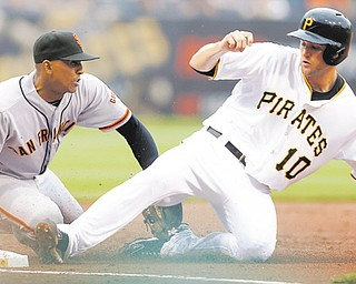 Pirates baserunner Jordy Mercer (10) is out as Giants third baseman Joaquin Arias, left, reaches to tag him Wednesday at PNC Park. For the second straight night, Pittsburgh defeated San Francisco.