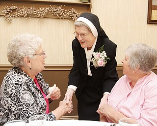William D. Lewis\The Vindicator.William D. Lewis\The Vindicator Sister Jerome Corcoran during a June 13, 2013 event at A La Cart Caterning in Canfield. She is shown with Ruth Lind Yurcich, left, of Struthers and Anna Margaret Jackson of Boardman. Both were 4th grade students of Sister Jerome.