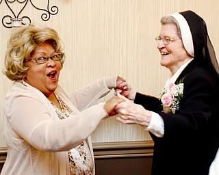 William D. Lewis\The Vindicator Sister Jerome Corcoran dances with Sophia Brooks during a June 13, 2013 event at A La Cart Caterning in Canfield. Brooks taught preschool at the Mill Creek Childrens Center. .William D. Lewis\The Vindicator.