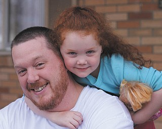 Brian Finnigan and his daughter Leah.  They live in Boardman. Leah adores her dad; he doesn't hesitate to have tea parties with her, as well as teaching her to hold a bat and throw a ball. Photo was taken by Anita Carano of Boardman..