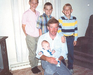 Larry Close of Beloit is in this 1992 picture with his four sons, Daniel, Shawn, Matthew and Adam. Photo was sent by Colleen Close.