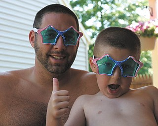 Ron Glista and his son Aaron pose for a picture on a hot summer day in 2012. They live in Boardman.