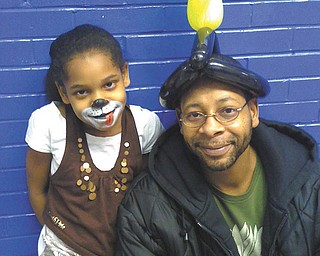 Christopher Donlow and his daughter Taylor, of Youngstown, are at her school carnival.