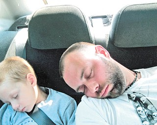 If backseat driving was their intention, then Eric Bourlier of McDonald and his son, Kyle, fell asleep on the job!