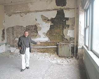 Kirk E. Kreuzwieser, vice president of Strollo Architects, says much of the interior of the 96-year-old Wells Building needs to be gutted. He and Gregg Strollo, company president, believe the $4 million-plus rehabilitation project could be completed in less than nine months after financial issues are resolved.