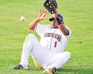 Scrappers right fielder Juan Romero falls as he attempts to reach the ball during the fifth inning of the team's season opener Monday against the Jamestown Jammers at Eastwood Field in Niles. The Scrappers fell 5-0.