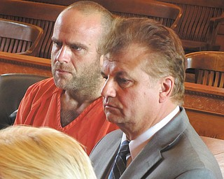 Scott H. Walker, left, of Bazetta Township stands with Matt Pentz of the Ohio Public Defender's Office in court Tuesday.
