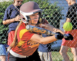 Cardinal Mooney's Shannon Saadey lays down a bunt for the Mahoning County team during Game 1 of the 10th annual 2013 Mahoning/Trumbull County High School All-Star Softball Game on Tuesday at McCune Park in 