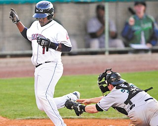 The Scrappers' Juan Romero cross home plate to score ahead of the tag by Jamestown catcher Max Rossiter during the fifth inning of Wednesday's game at Eastwood Field. It was the first run of the 2013 season for the Scrappers, who rallied in the ninth to down the Jammers, 7-6.