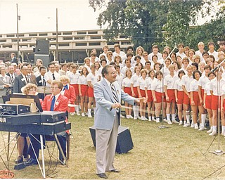 The late Glenville Thomas is shown directing the All-Ohio State Youth Choir during a performance at the Ohio State Fair for foreign visitors. The choir will reunite and sing at the fair this August to commemorate the 50th anniversary of the founding of the choir by the former Zanesville music director. Special to The Vindicator