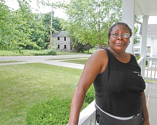 """For Marshone Blair, who's lived at 906 Woodland Avenue with her family for the past three years, paving work can't come soon enough. """"We've been waiting forever for it to be fixed. They've never paved this road since I've been here, and it's getting worse,"""" she said."""