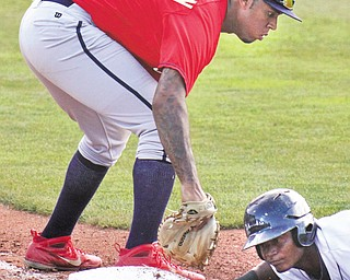 Mahoning Valley's Juan Herrera gets back to first as State College first baseman David Washington (32) tries to make the tag on pick-off attempt during a New York-Penn League game Thursday night at Eastwood Field.