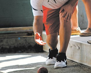 Nick DeCesare plays bocce during the benefit for Cardinal Mooney High School.