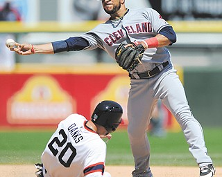 Cleveland Indians second baseman Mike Aviles, right, throws to first base after forcing out Chicago White Sox's Jordan Danks at second base during the sixth inning of a game in Chicago on Sunday. Cleveland won 4-0.