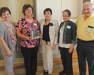 SPECIAL TO THE VINDICATOR The Historic Preservation Society of the Mahoning Valley Historical Society Board of Trustees presented the 2013 Community Revitalization Award to Girard Historical Society at its annual awards program June 18. Girard Historical Society members, from left, are Roselyn Gadd, Roberta Lawrentz, Mary Anne Creatore, and Colette and Ralph Chuey. The award was for the group's work for restoration, reconstruction and preservation of the Henry Barnhisel House in Girard, which is open to the public on the second and fourth Sundays of each month. Mementos can be purchased. Donations are accepted. For information visit www.girardhistoricalsociety.org.